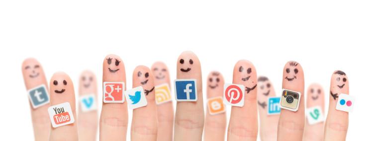 Finger With Popular Social Media Logos Printed On Paper.